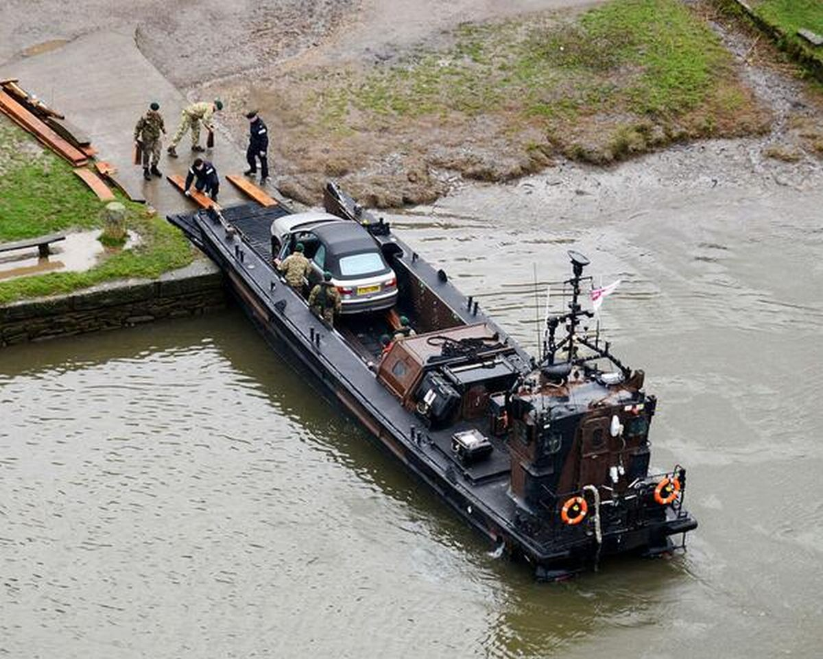 Grateful villagers have praised the Royal Navy for recovering cars stranded in a flood-hit village in SE Cornwall by moving them down river by Royal Marines landing craft.