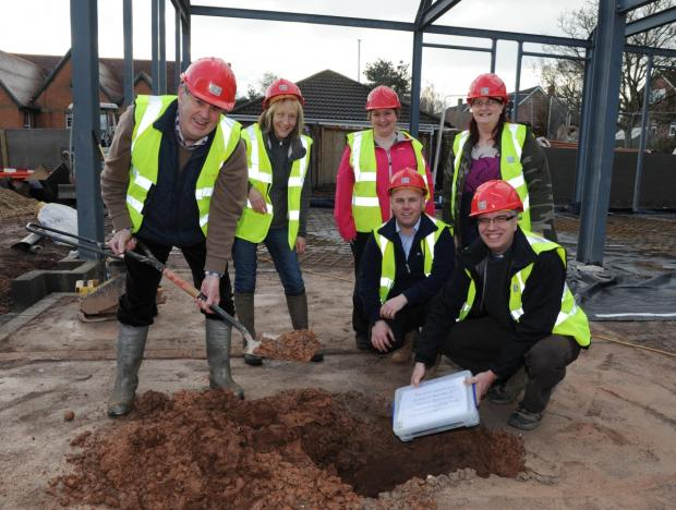 Burial of the time capsule, from left, back, Barry Bloxham, Sam Upham, Linda Briary and Katie Escott; front, project manager for CG Fry and Son Marc Parsons with Rev Adrian Youings.