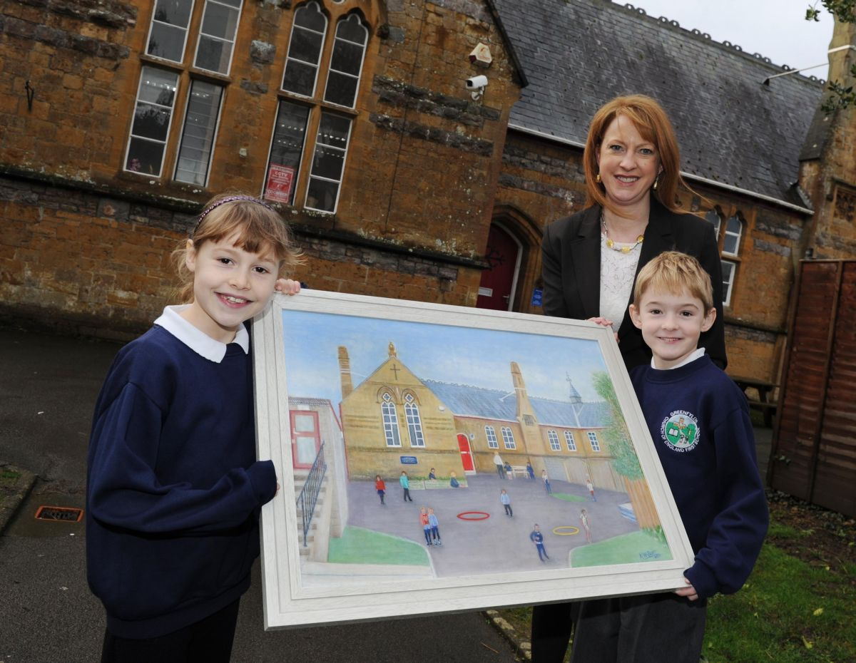 HEAD teacher Claire Oaten with pupils Evie and Josh and the oil painting. PHOTO: Geoff Hall