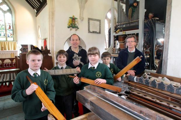 BILLY Munro, Ferdy Smith, organ restorer Michael Farley, Gabi Onody, Charles McConville and organist William Reese, who is leading the restoration campaign. PHOTO: Steve Guscott