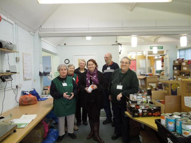 Cllr Justine Baker, Prospective Parliamentary Candidate for Bridgwater, with Ted Stock and volunteers of Food Bank, appealing for help with a new home. Photo: submitted.