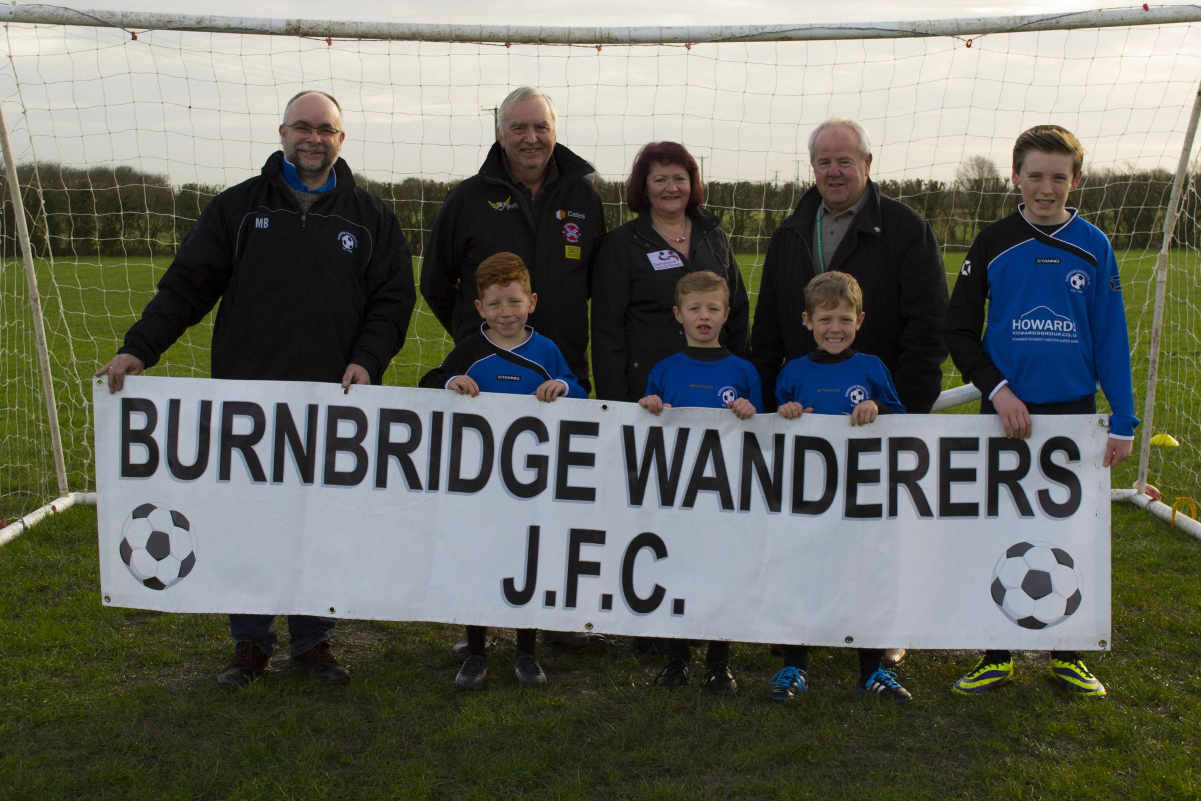 Burnbridge Wanderers present charity cheque