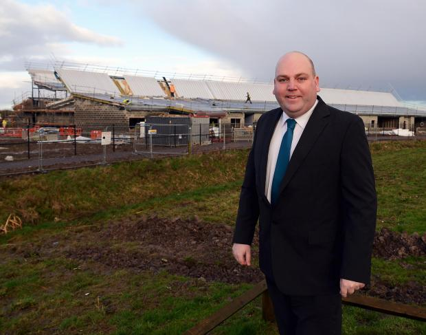 Principal Nick Riddiough outside the building site for the new Bridgwater School.