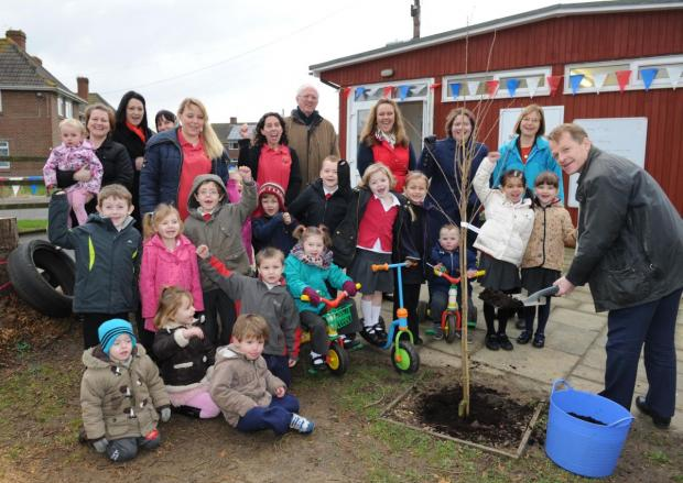 This is The West Country: CHILDREN, staff and parents celebrate as David Laws MP plants a cherry tree at the pre-school's