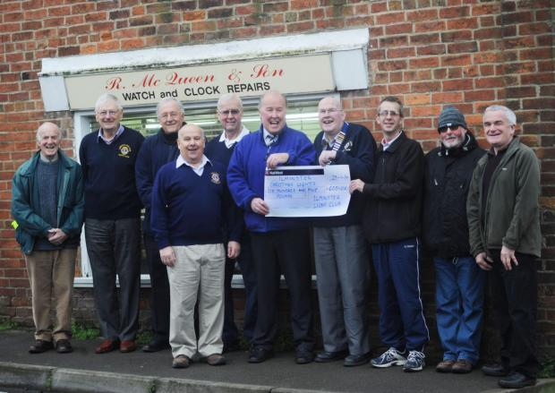 MEMBERS of Ilminster Lions present a cheque to Glenn McQueen and Clinton Bonner of Ilminster Christmas Lights Committee.