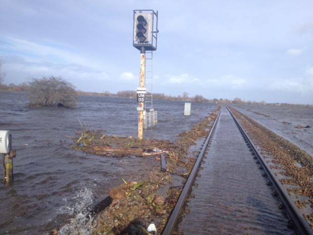 This is The West Country: FLOODED: The railway line between Taunton and Bridgwater - a replacement bus service is in place.
