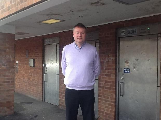 Cllr Ross Henley outside the public toilets in Longforth Road.