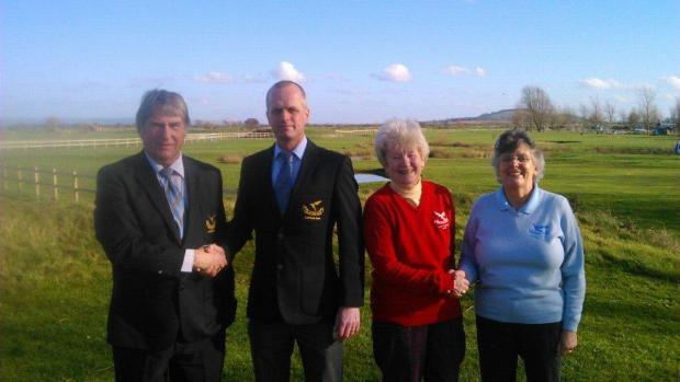BRIAN Read (2013 Capt) handing over to Paul Jones and Annie Williams accepted the congratulations from Sheila Rouse (2013 Ladies Capt)