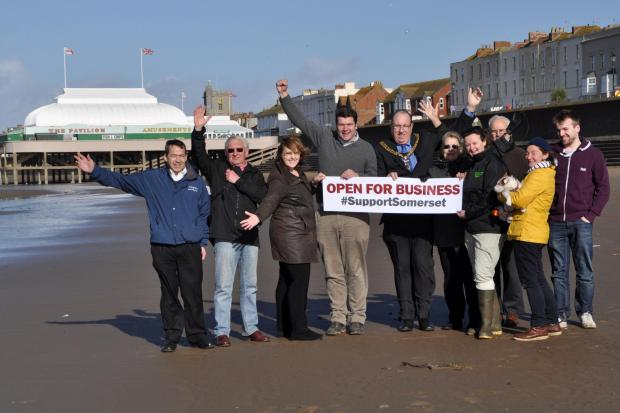 BURNHAM and Highbridge Mayor Martin Cox, with business owners on Burnham beach, spreading the message the town is open for business.