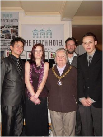 MINEHEAD Mayor Valerie Welch with Dave Jackson, manager of the Beach Hotel and Matthew Sutcliffe, Karl Hitchcock and Louise Watkins from the YMCA. PHOTO: Submitted.