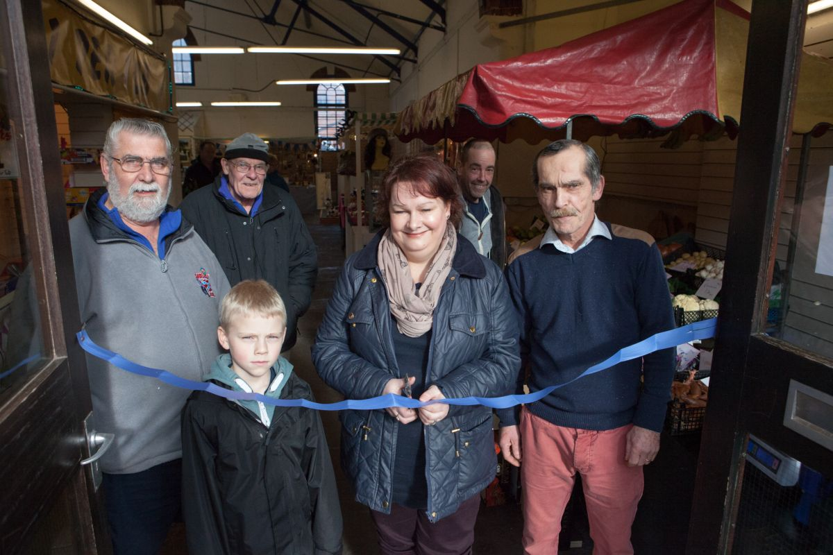 CLLR Justine Baker opening the revamped indoor market in Minehead with propietor Mike Doody and stall holders. PHOTO: Submitted.