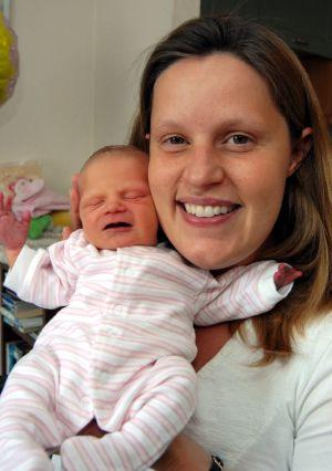 Overjoyed mum Lena proudly shows off baby Lucianna Grace, who defied doctors to be born healthy.