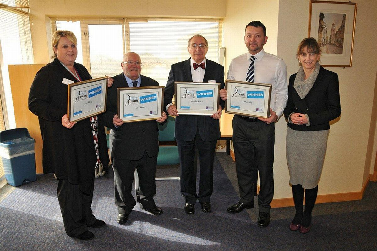 LYNN Parry, Colin Parsons, Stewart Lawrence and Shane Eckley receive their awards from PCC Sue Mountstevens. PHOTO: Avon and Somerset Police.