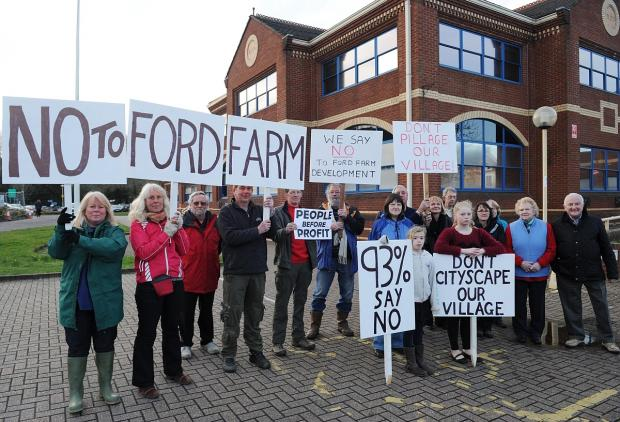 This is The West Country: Protesters against the Ford House Farm development outside Deane House in Taunton.