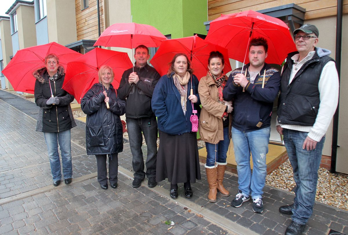RESIDENTS with some staff from Magna braving the rain at Brackensfield. PHOTO: Submitted.