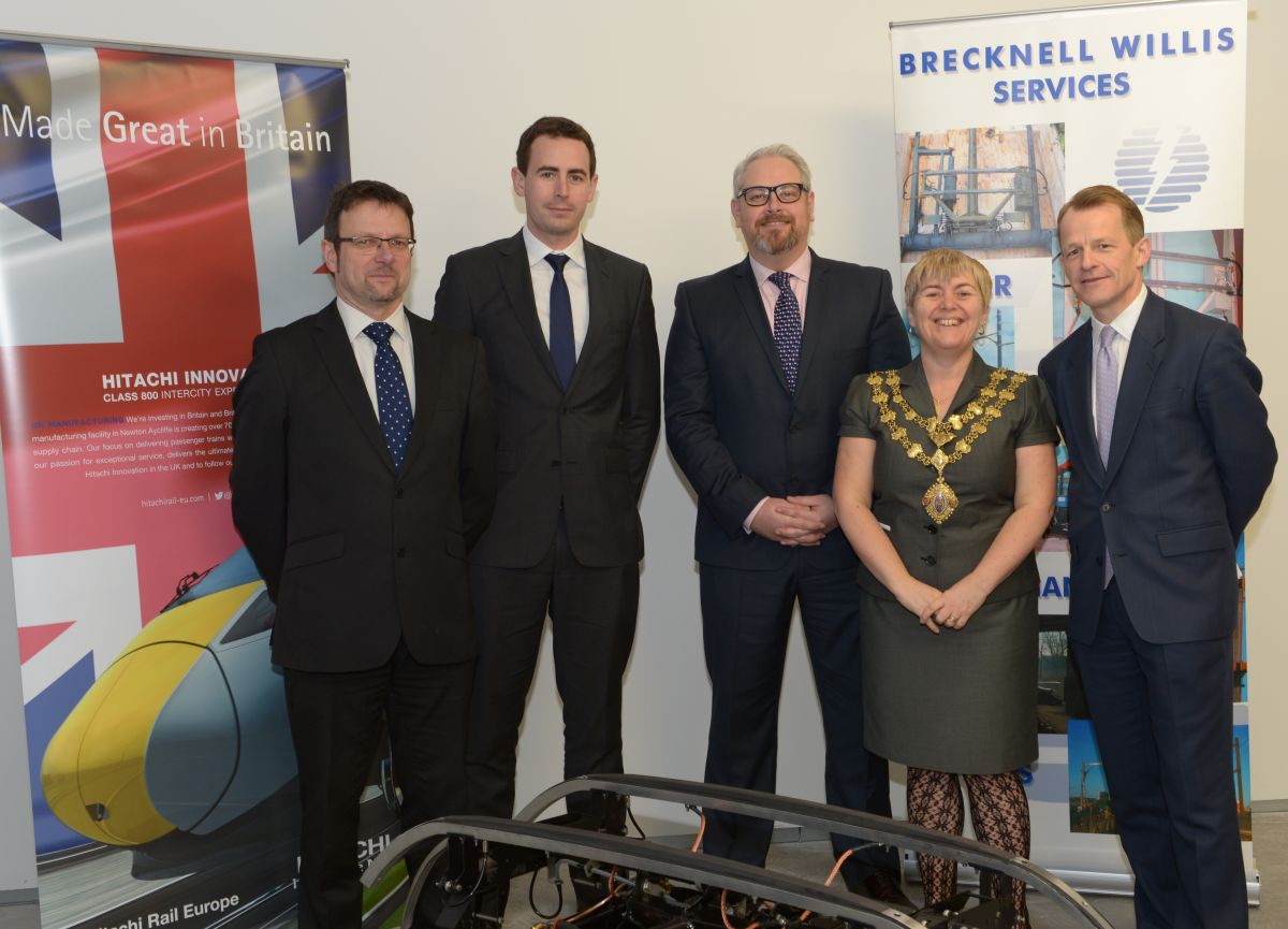 BRECKNELL Willis managing director Richard Whitefield with Ben Snodin and Jamie Foster from Hitachi, David Laws MP, and the Mayor of Chard, Cllr Jenny Kenton.