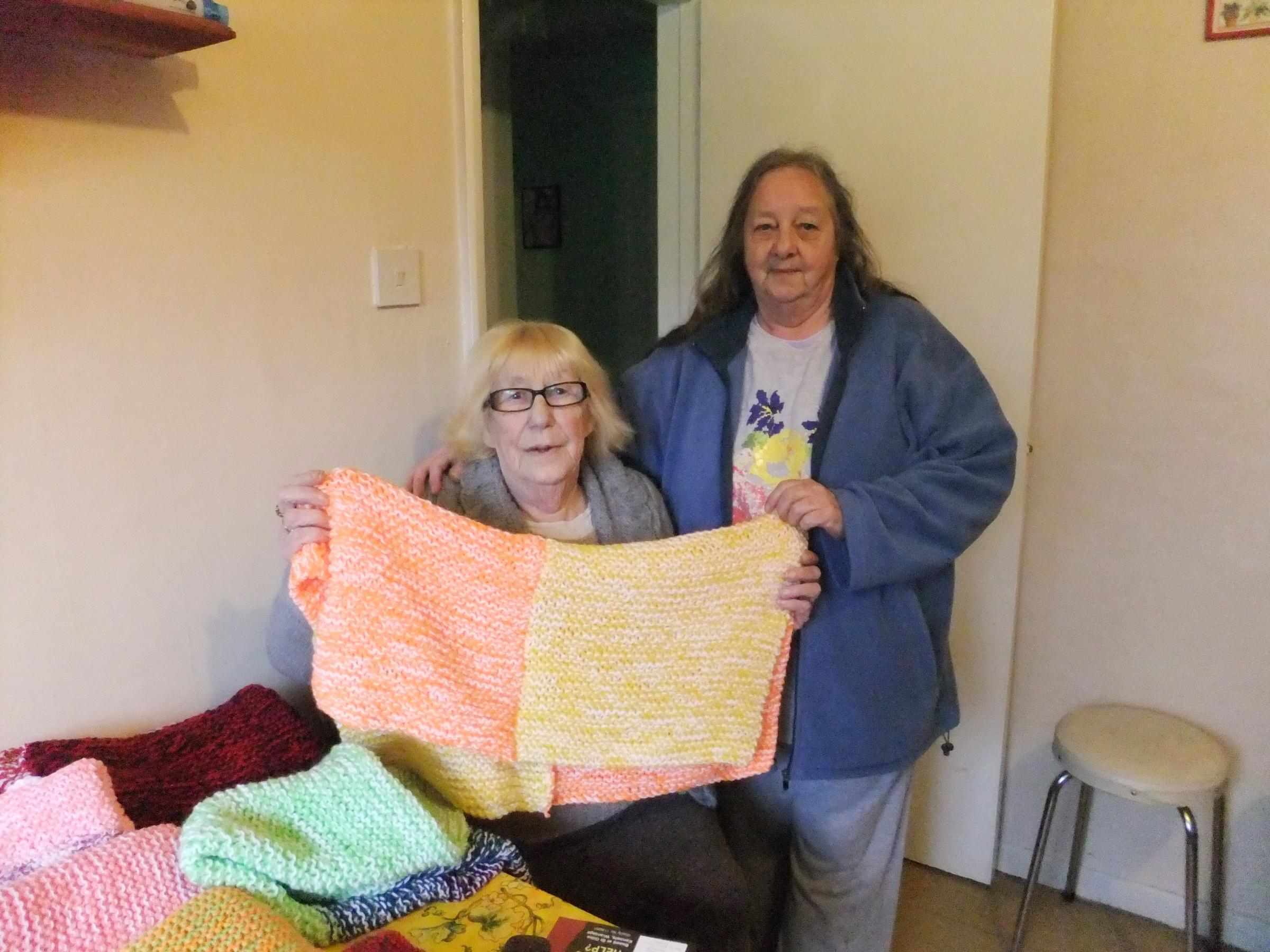 Celia Alison and Gloria Taylor with some of their blankets.
