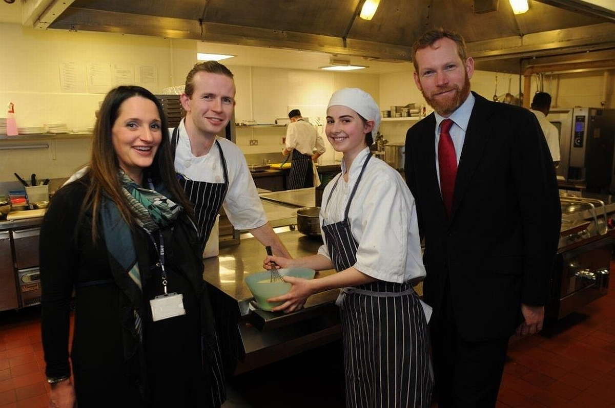 Gemma Staple in the kitchens at the Castle Hotel with head chef Liam Finnigan, MP Jeremy Browne and a Somerset College representative.