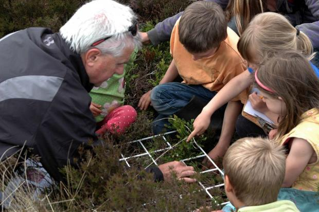 DAVE Weatherly, curriculum advisor with local children exploring Moorland Classroom sites. PHOTO: Submitted.