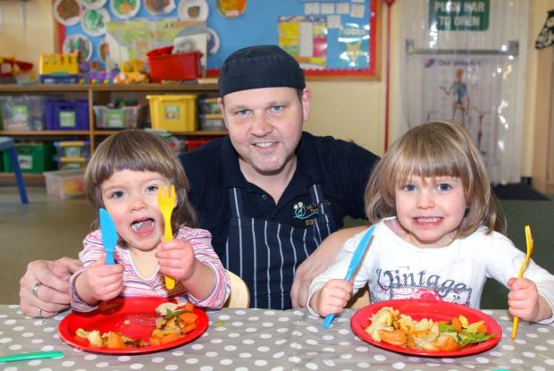 LAURA Angell, chef Richard Forman and Jessie Angell tucking into their tasty healthy hot meals. PHOTO: Steve Guscott.