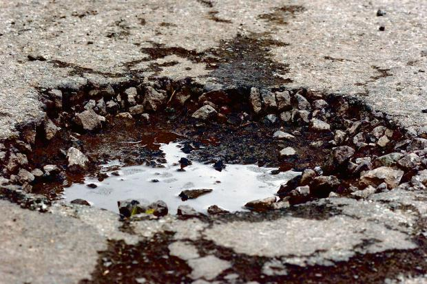 £6,985,437 to help repair potholed Devon roads