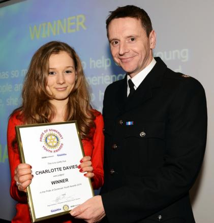 CHARLOTTE Davies receives her award from Supt Ian Wylie, of sponsors Avon and Somerset Constabulary.