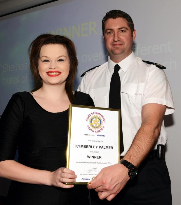 This is The West Country: KYMBERLY Palmer receives her award from Gavin Ellis, of sponsors Devon and Somerset Fire and Rescue Service.