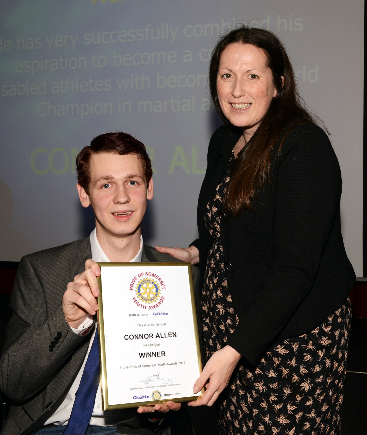 CONNOR Allen receives his award from Tamsin Curnow, editor of BBC Somerset.