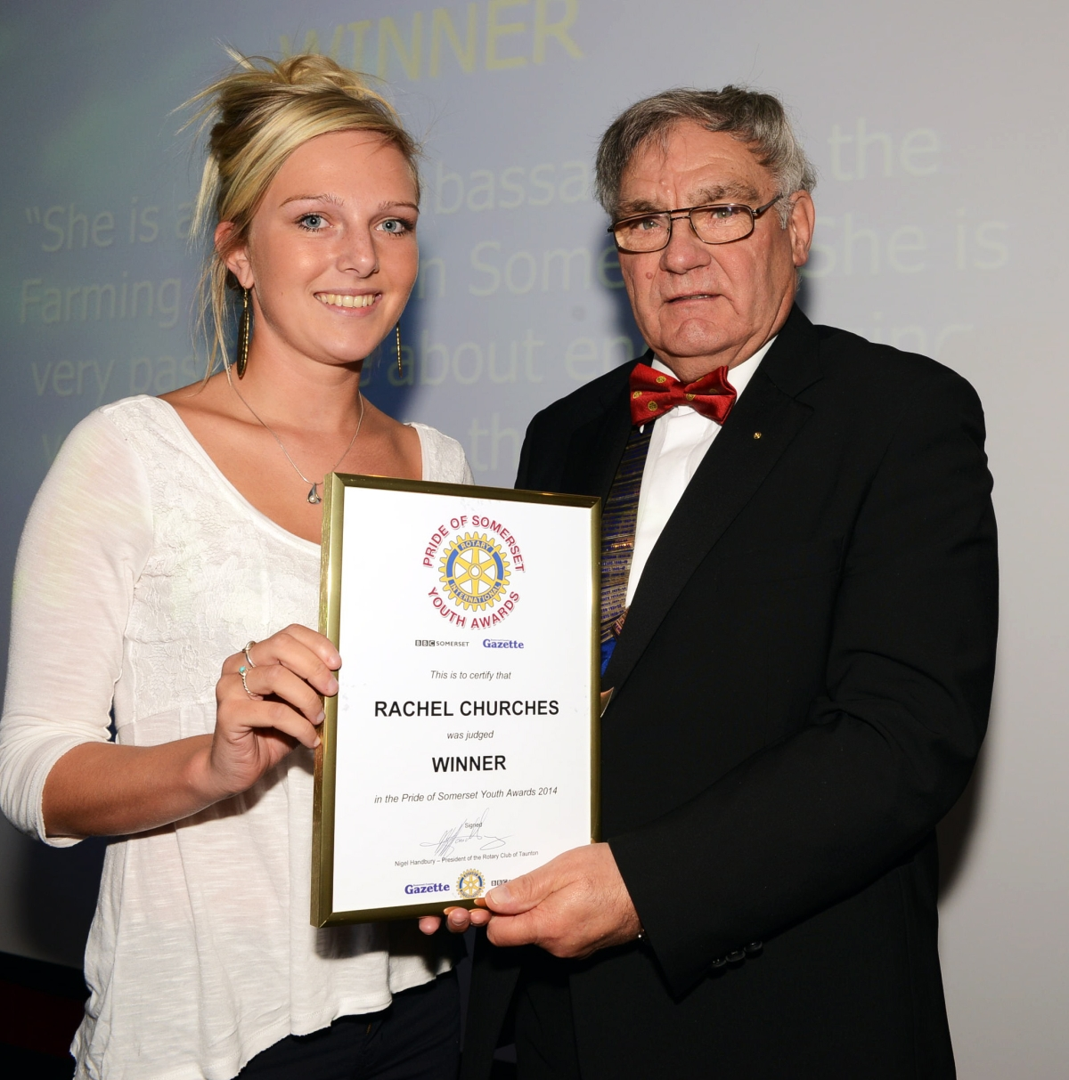 RACHEL Churches receives her award from Nigel Handbury, president of the Rotary Club of Taunton.