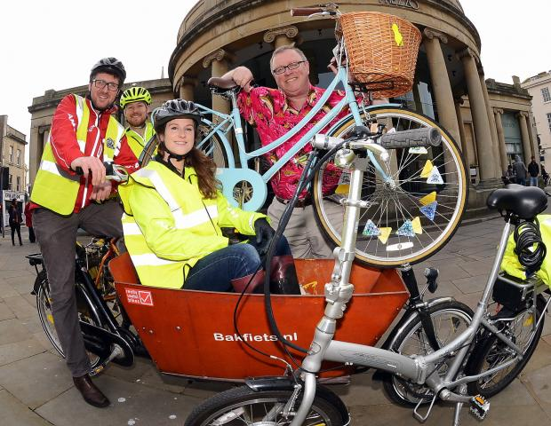 Patrick Williams, Sim Benson, Flo Marshall and Chris Hutchinson show off how bright everyone will look at the Neon Bike Ride.