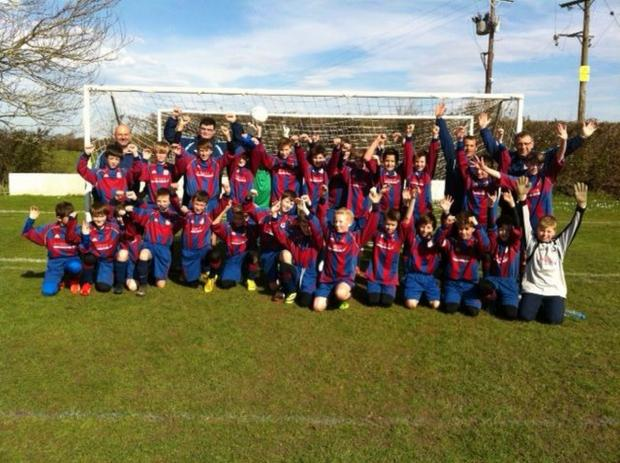 Wembdon junior footballers celebrate getting their new playing fields.