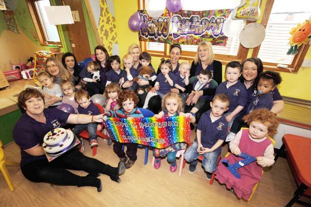 Karebears staff and youngsters celebrate, with founder Karen Davey in the foreground, left.