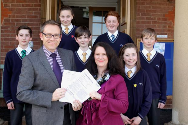 DEPUTY head teacher Steve Bond and chairman of governors Martina Forster with pupils (from left) Harry Holmwood, Becky Ansell, Benjamin Forster, Alfie Martin, Jodie Delbridge and Rob Speed. PHOTO: Steve Guscott.