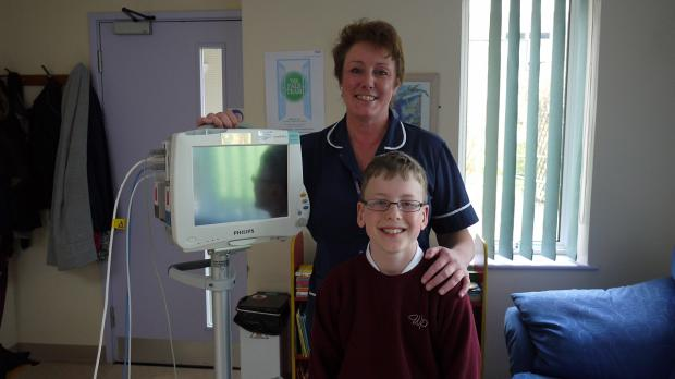 Jack with matron Sue Spooner and the monitor named after him.