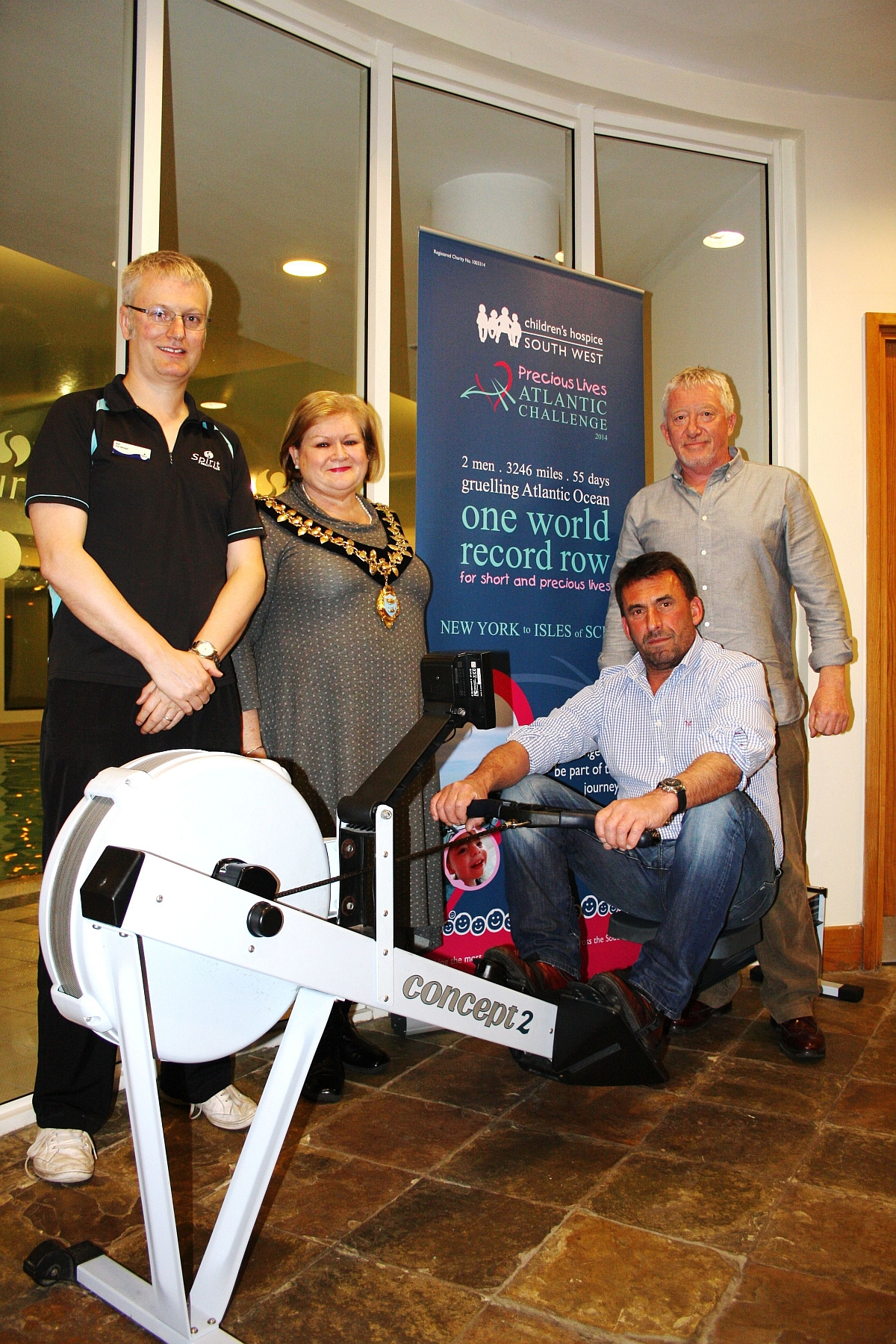 Rowers Chris 'Darby' Walters, right, and Elliot Dale, seated, with Spirit Health Club mnagager Mark Ha