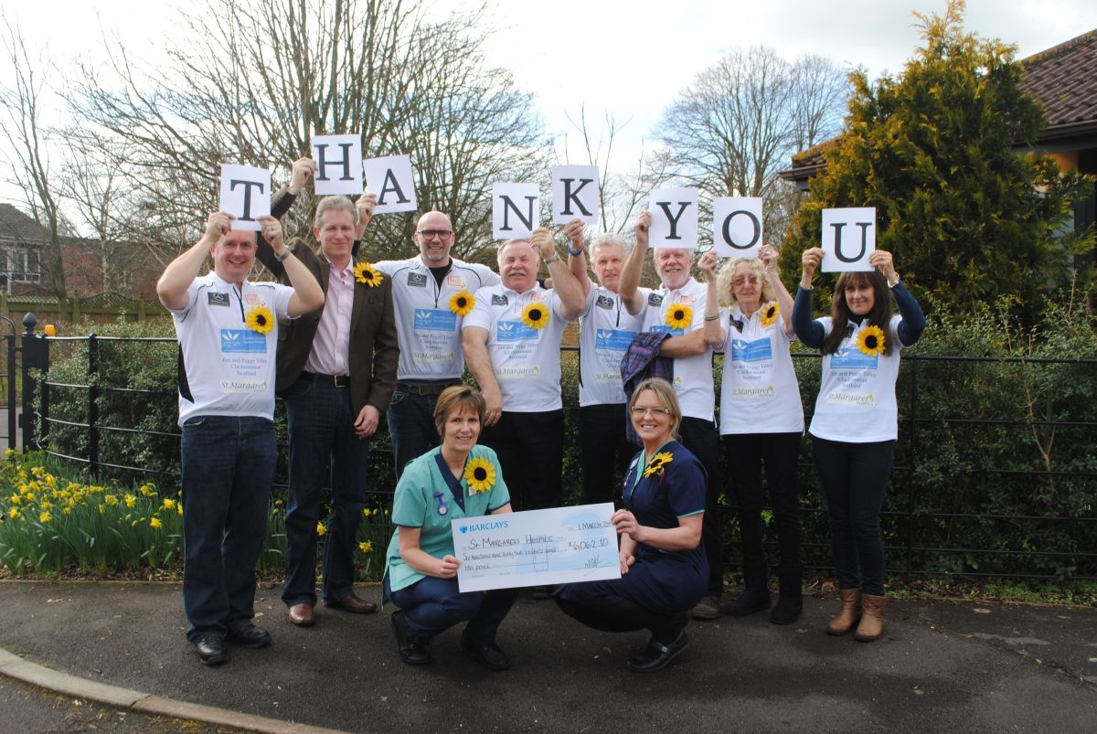 PAUL Harrison, centre, with his family who supported him on the challenge and nurses from St Margaret's Hospic