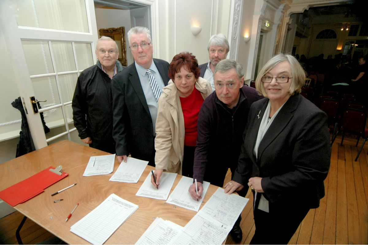 RESIDENTS and councillors Martin Dewdney (rear) and Christine Lawrence (front) support hotelier Bryan Leaker (second left) by signing a petition. PHOTO: Paul Courtney.
