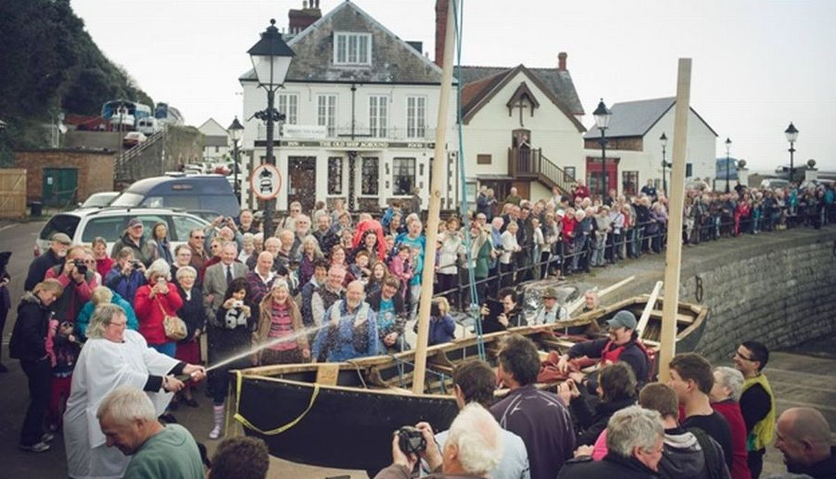 THE Rev Dobbin blesses the Currach before it makes its maiden voyage. PHOTO:.Taphouse Photography.