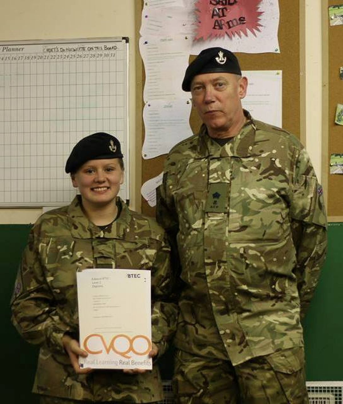 Cadet Shannon Came receiving her BTEC certificate from adult instructor Major Trunks at Cannington Platoon.