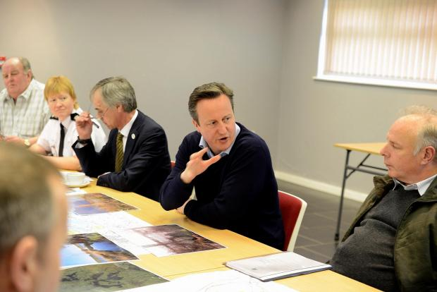 This is The West Country: Prime Minister David Cameron speaks to Bridgwater MP Ian Liddell-Grainger and Sedgemoor councillors
