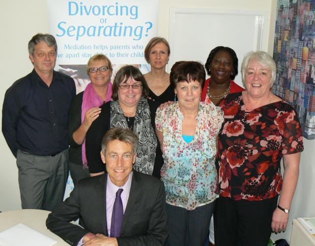 Ben Bradshaw MP (front) with NFM staff: from left Paul Player, Ros Vincent, Niki Tucker, Sarah Grant, Sue Fowles, Norma Junaid, Jane Robey.