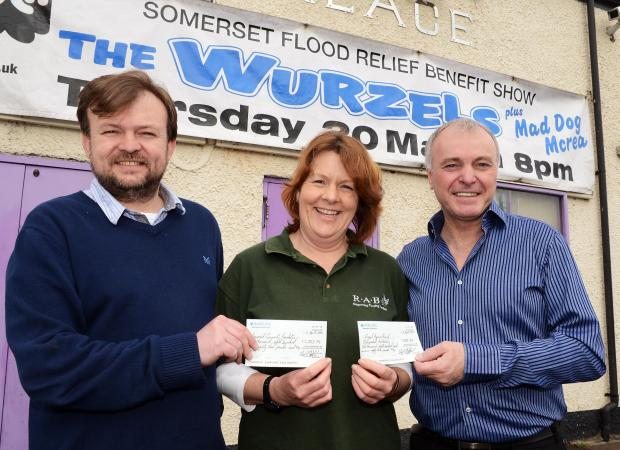 MATT Barlett presents the cheque to Pam Wills, Royal Agricultural Benevolent Institution, with Clive Lilley, who runs The Palace nightclub.