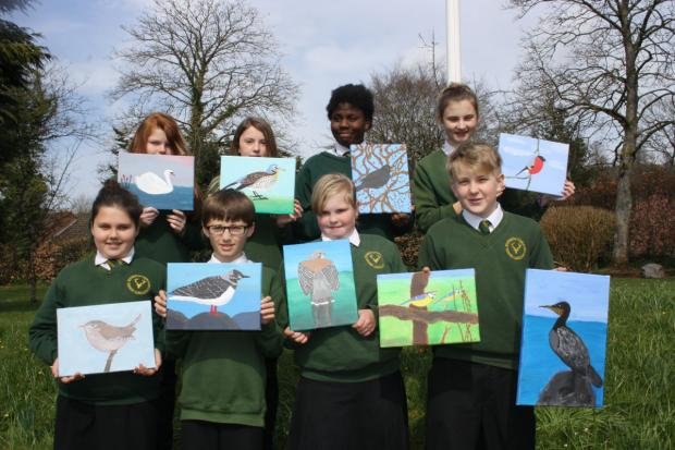 DULVETON Middle School pupils with their British bird paintings, from left, back: Erin Jones, Georgina Retallick, Lulu Agbami and Alex Ke