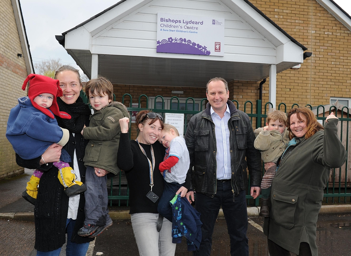 Cllr Mike Rigby with children and parents outside Bishops Lydeard Children's Centre.