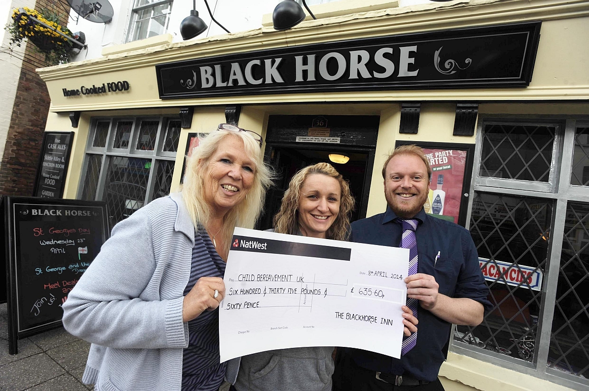 Beverley Higgins, owner of the Black Horse, with Clare Farmer and Gary Bishop, pub manager.