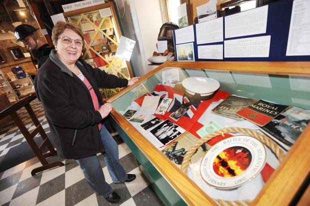 Margaret Ridley with Royal Marines memorabilia.