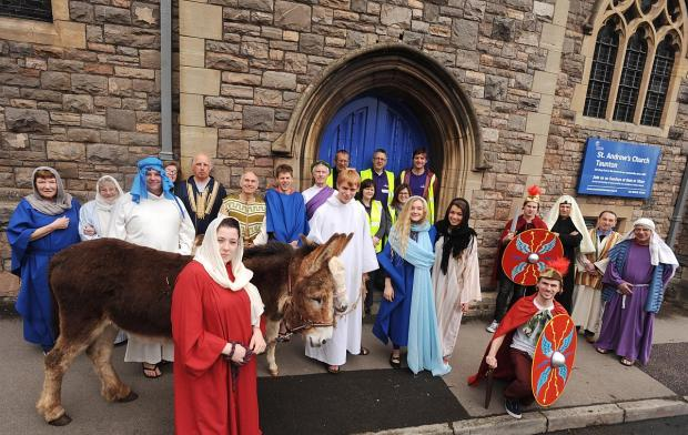 The Easter re-enactment, complete with donkeys, outside St Andrew's Church.