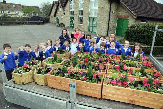 The children from Kingsmoor planted flowers and gave them to the church in Moorland.