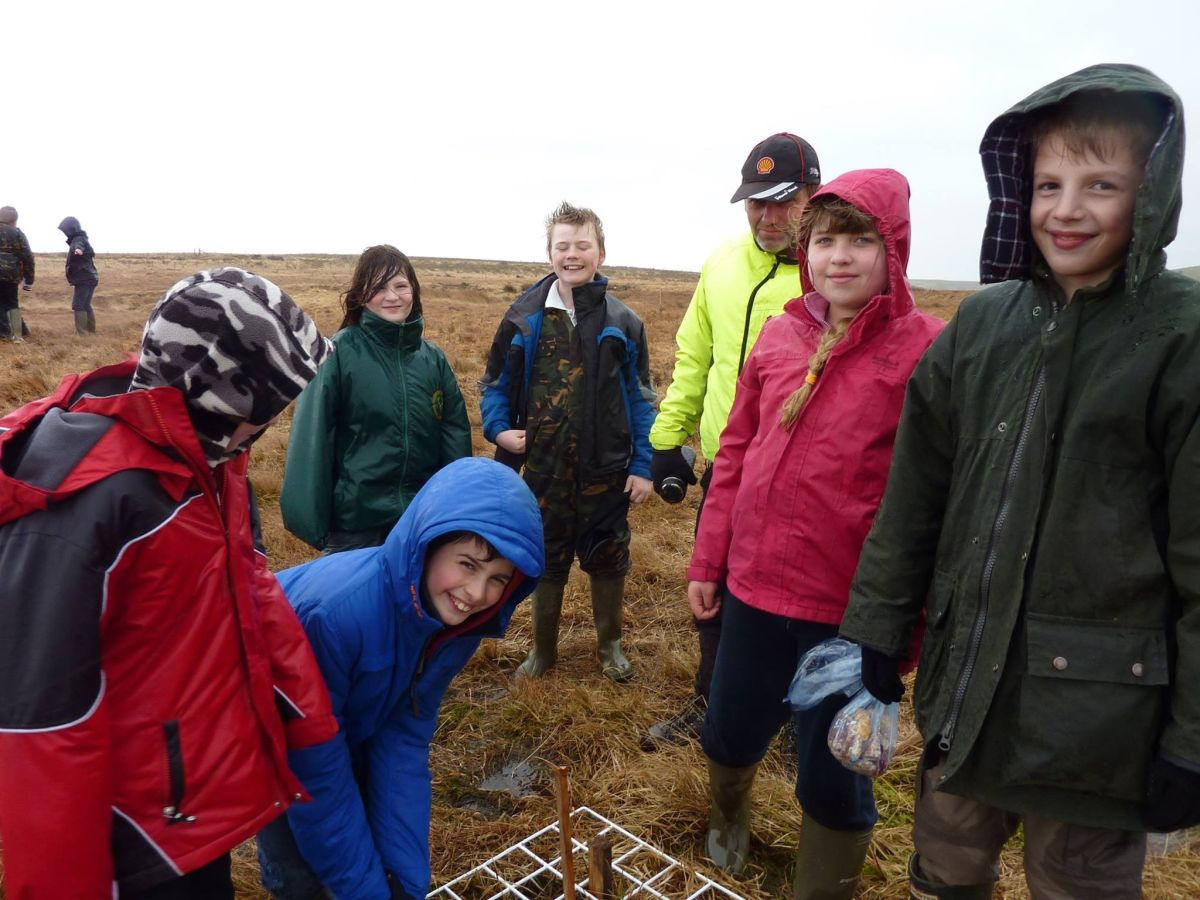 BUDDING bog ecologists from Dulverton Middle School out in the rain on Exmoor ... and thoroughly enjoying it. PHOTO: Submitted.
