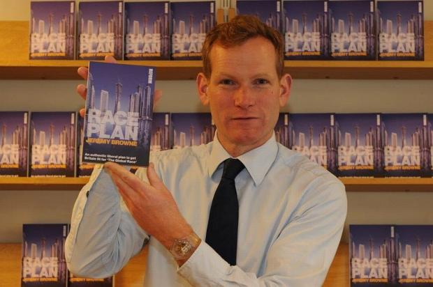 Jeremy Browne with his book, 'Race Plan'.